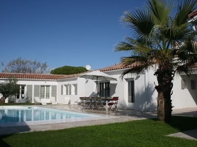 Photo for LE BOIS PLAGE peaceful heated pool, close to the beach and the town