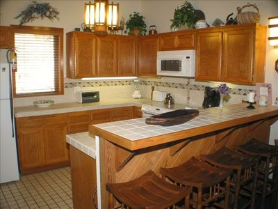 Fully-Equipped Kitchen w/ Range, Oven, Microwave, & Dishwasher. Laundry adjacent
