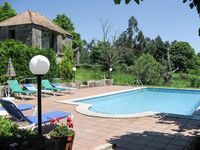 A lovely village house in the hills , with pool and large garden