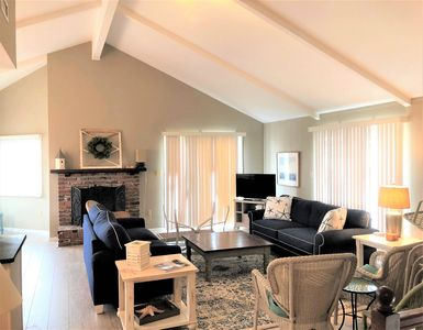 Photo for Classic 4 bedroom 3 bath upside/down home enjoys a great north end beachblock location.