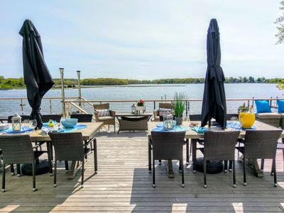 Large open deck  with ample seating and dining options