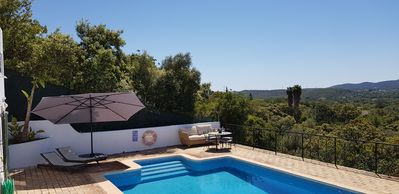 Lower pool terrace with superb panoramic valley & distant sea view