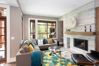 Living room with sectional sofa and gas fireplace