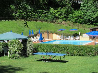 Swimming-pool with area equipped with tennis-table and other games