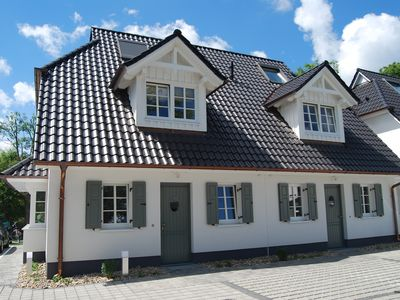 Photo for Chic and comfortable living in Zingst - WLAN, Sky, fireplace, sauna, close to the beach