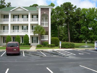 Front of Condo with Golf Course Behind Unit