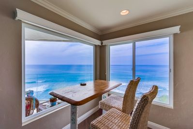 Living Room - Dine inside or outside. Either way you will enjoy spectacular views!