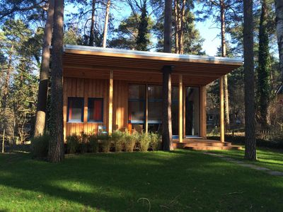 Photo for beautiful wooden house, bungalow, 300 m to the lake, large garden, covered porch