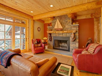 Photo for Uber-Luxe Lakefront Handcrafted Log Paradise with Heated Pool, 7 miles to town