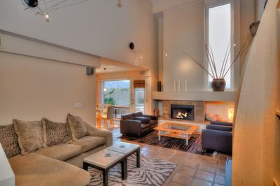 Relax by the fire while enjoying the great mountain views.