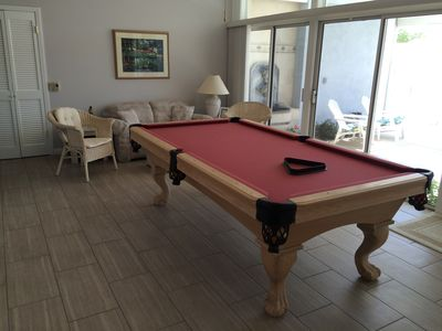 Pool table room leading out to courtyard with pool and spa