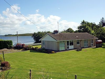 Photo for Detached bungalow in large garden beside and with fine views over the vast island-studded Loug…