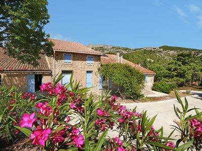 Photo for Luxury air-conditioned gîte in wine farm with heated pool and stunning views