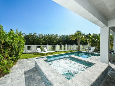 Photo for NEW HOME ON CANAL - Sleeps 18 in 6 Bedrooms w/ 6.5 Baths - 2 Minutes to Beach - Kayak and Paddleboard Included. Private Heated Pool and Spa. Property Manager Program Included.