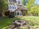 Spacious yard. Fire pit with firewood.