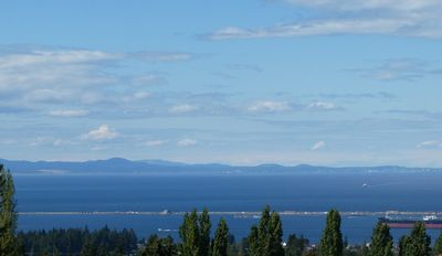 View of harbor, Strait, and Canada, as seen from the front of the house.