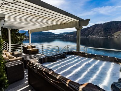 Photo for Modern and stunning lakefront home! Views, private hot tub, deck, and dock!