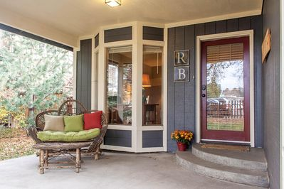 This sweet riverfront home is in a great walkable westside location