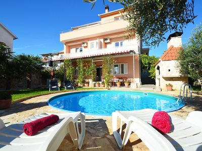 Photo for This 8-bedroom villa for up to 16 guests is located in Vodice and has a private swimming pool, air-c