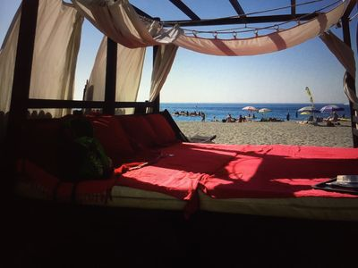 Relax on the local beach in a Moroccan style four poster sun beds.