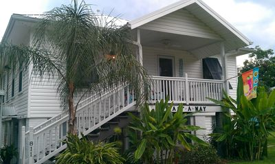Front View of the Castaway in May with lush tropical plants at your feet.
