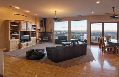 Our living room, with bay windows for an unimpeded view of the Red Rocks.