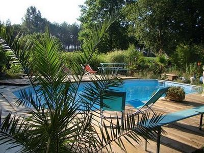 Photo for Landaise house with pool near the ocean for 15 people