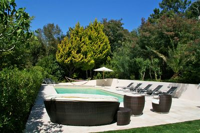 Fabulous heated pool with beautiful stone terrace and outside entertaining area.