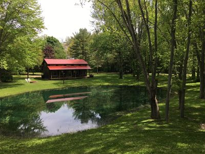 Photo for Beautiful Cabin in the woods w/pond and 5.5 acres.  Privacy within town.