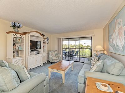 Photo for BOOK WITH US! Midnight Cove II Bayside –2nd fl by lagoon free wi-fi, central ac, beach access.