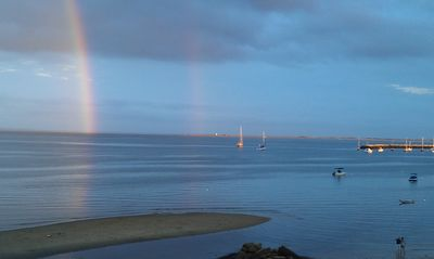 Double rainbow over the harbor as seen from the private deck