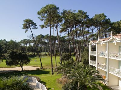 Photo for apartment with view over the golf course, swimming pool