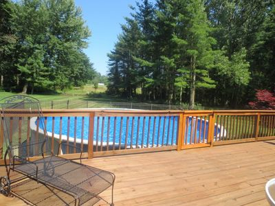 24 foot round above ground pool off deck