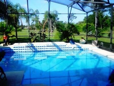 Heated Pool in enclosed patio overlooking golf course with privacy.