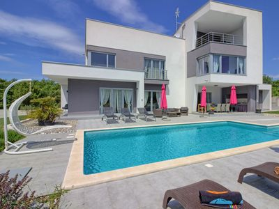 Photo for This 4-bedroom villa for up to 8 guests is located in Pula and has a private swimming pool, air-cond