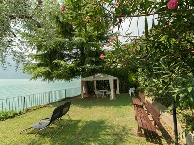 Photo for NEST ON THE LAKE facing the lake, private beach, air conditioning SEPT-OCT OFFERT