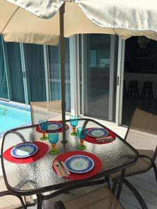 Dining by your pool toward the villa