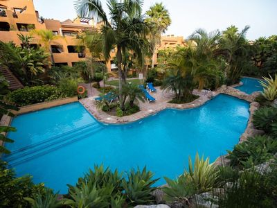 Photo for Comfortable penthouse in a tropical garden with two pools and a calm atmosphere.