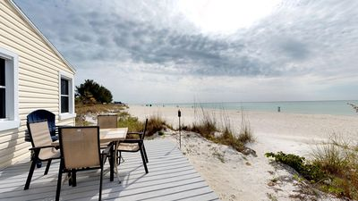 Photo for Gulf-front home with deck and direct beach access - steps to trolley!