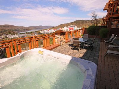 Private terrace with private hot tub and breathtaking views of the resort & lake
