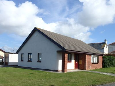 Photo for Modern 3 bedroom bungalow in a quiet location and within 10 mins walk of beach