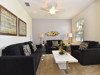 Photo for Home near Disney w/ WiFi, Pool, Spa, Resort Pool, Tennis, Gym & Playground