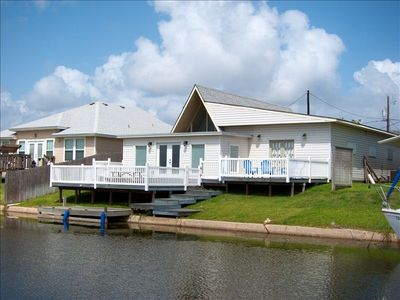 Large wrap around back deck with own personal boat dock! Great boating access!