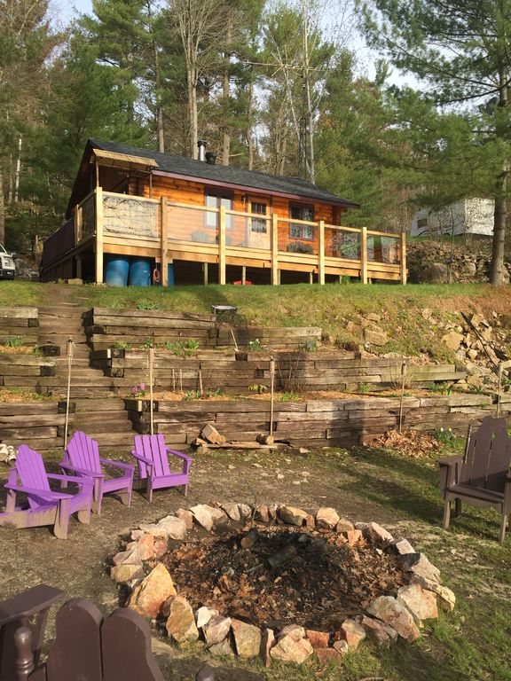charming lake and rental rent thousand gananoque for hidden cottage vacation treasure fire br pit waterfront leeds from the islands on cottages