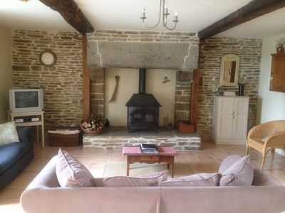 Your lounge at Le Clos. A warm welcome awaits from the woodburner.