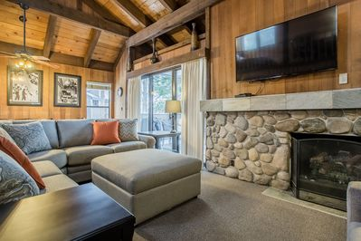 Newly updated! Enjoy plenty of seating, the large HDTV, and warmth of the gas fireplace