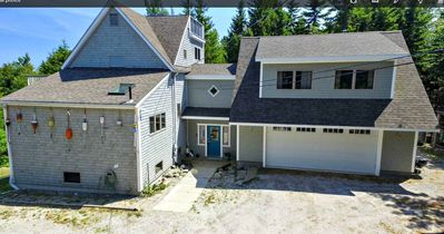 Photo for Spacious 5 bedroom home just a short walk to local beach and ocean views from the upper decks!