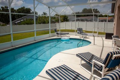 Southern exposure pool  Free pool heat lounge chairs and tables