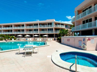 Photo for Relaxing condo w/ shared pool and hot tub, walk to dining and free trolley!