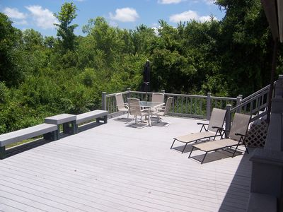 Spacious deck with view of woods near Thornton Creek